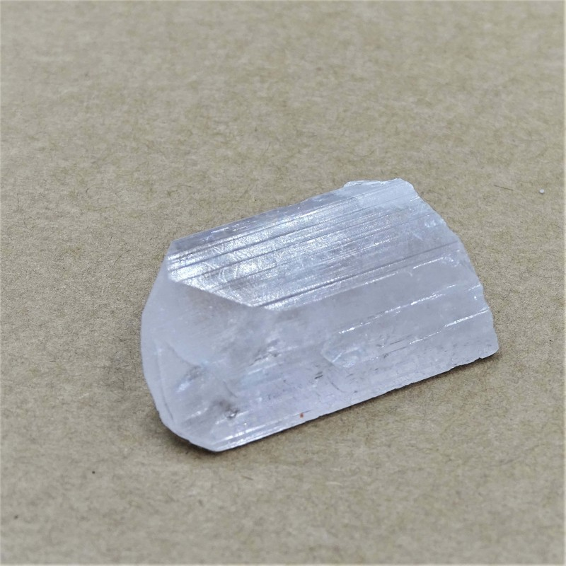 Nice natural crystal of danburite with typical grooves, clear inside and well transparent